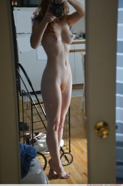 Artsy redhead nude selfie