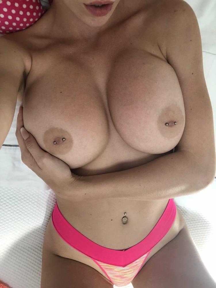 Tanned freak with huge juicy boobs